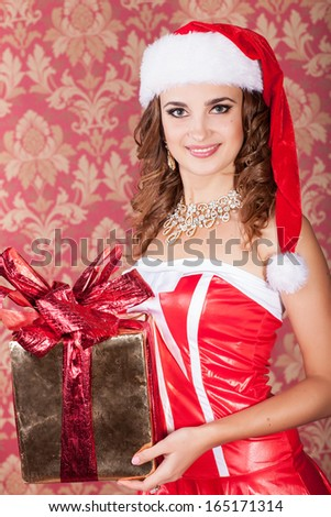 Christmas woman, new year concept, happy girl in santa claus hat, smiling girl with new year gift, winter concept. Santa helper elf with xmas gift at new year tree. winter concept. - stock photo