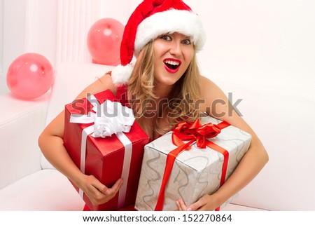 Christmas woman portrait hold red christmas gift - stock photo
