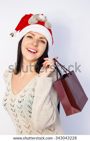 Christmas woman, Santa hat portrait. Gift box. Smiling female model. 2016 year