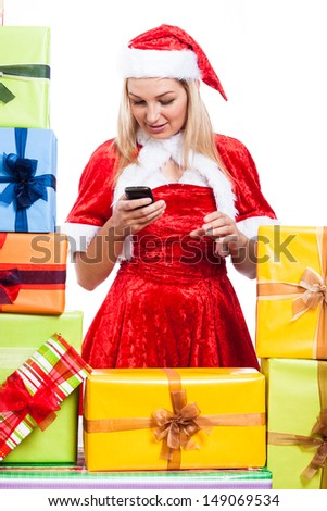 Christmas Woman texting message with phone surrounded by presents, isolated on white background.