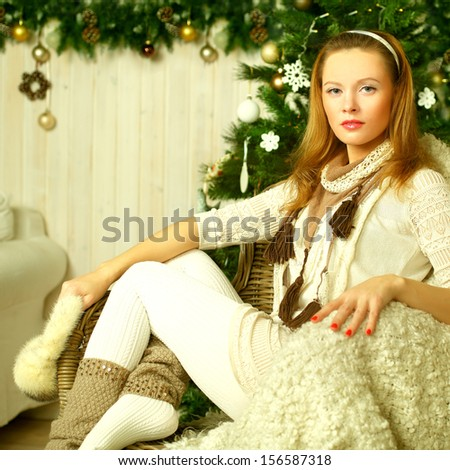 Christmas woman with retro styled makeup at vintage home - stock photo