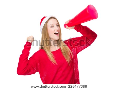 Christmas woman yell with megaphone - stock photo