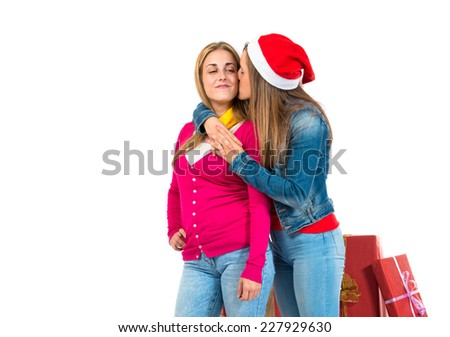 Christmas women with gifts over white background - stock photo