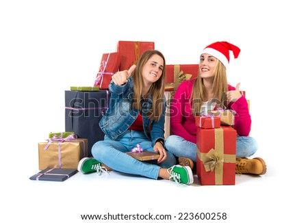 Christmas women with thumb up over white background