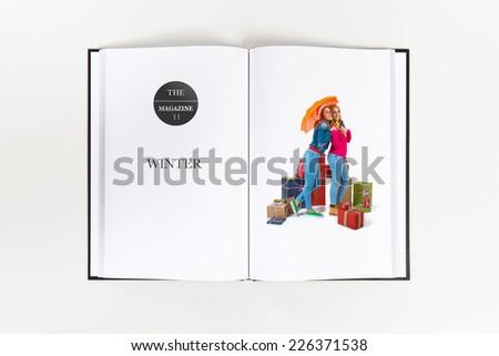 Christmas women with umbrella printed on book - stock photo