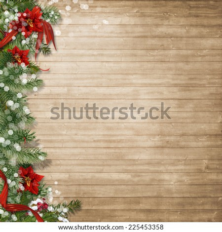 Christmas wood background  with poinsettia and firtree - stock photo
