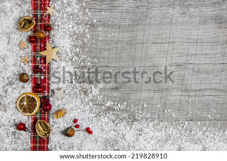 Christmas wooden background, advertising board or frame with a red bow.  - stock photo