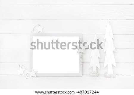 Christmas wooden background in brown and white color with carved trees for a xmas card or a mock up.