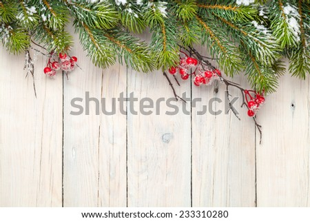 christmas wooden background with fir tree and holly berry view from above with copy space - Antique Christmas Lights