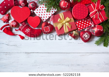 Christmas wooden background with gift boxes, decorations and fir branches