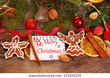 christmas wooden background with homemade gingerbread cookies ,spices,greeting card and decoration - stock photo