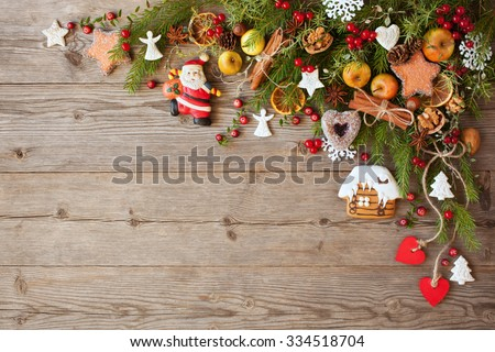 Christmas wooden background with ornaments - stock photo