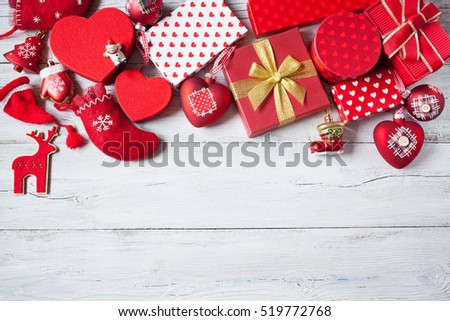 Christmas wooden background with presents in boxes, socks and decorations