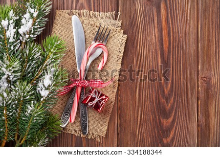 Christmas wooden background with silverware and snow tree - stock photo