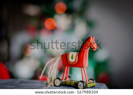 Christmas wooden horse standing on wheels - stock photo