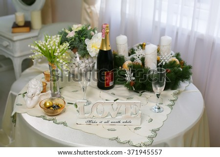 Christmas wooden word Love decoration, flowers on the table