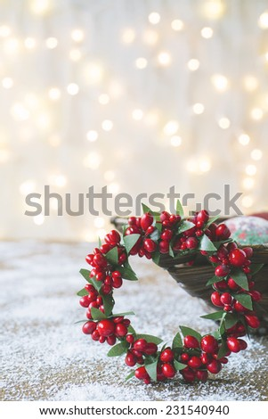 Christmas wreath against festive lights background - stock photo