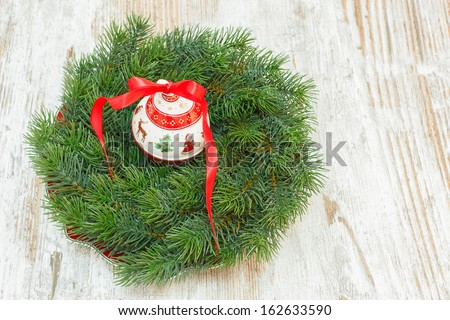 Christmas wreath. Christmas wreath and ornaments over old wooden  background. Copy space composition - stock photo
