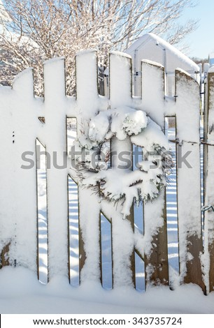 Christmas wreath decorating a garden gate. - stock photo