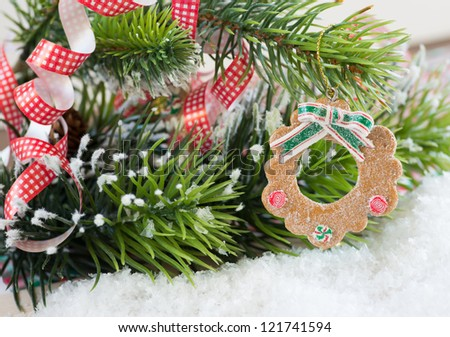 Christmas wreath decoration on decorated tree - stock photo