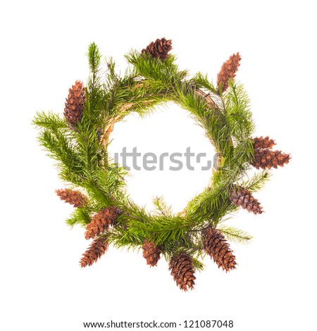 Christmas wreath from spruce branches with cones - stock photo