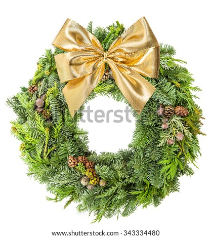 Christmas wreath from spruce, pine and fir twigs with golden ribbon bow isolated on white background. - stock photo