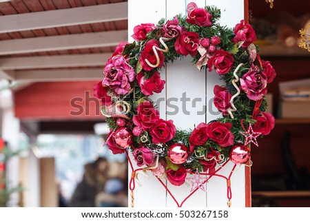 Christmas wreath handle on the wooden house