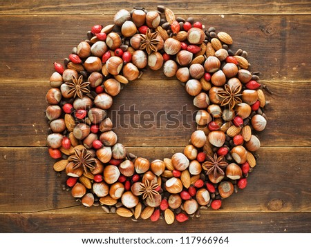 Christmas wreath made of nuts and spices. Viewed from above. - stock photo