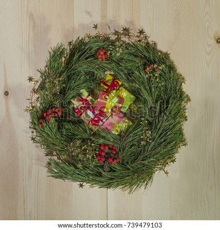 Christmas wreath of fir on a wooden background 2018