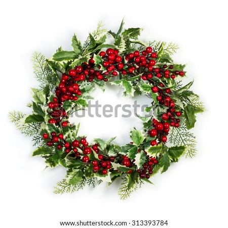 Christmas wreath of holly berries and leaves isolated on white background - stock photo