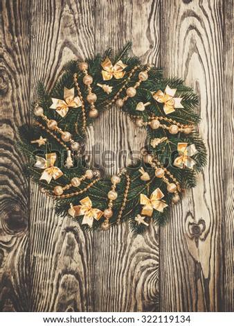 Christmas wreath on a rustic wooden front door - stock photo