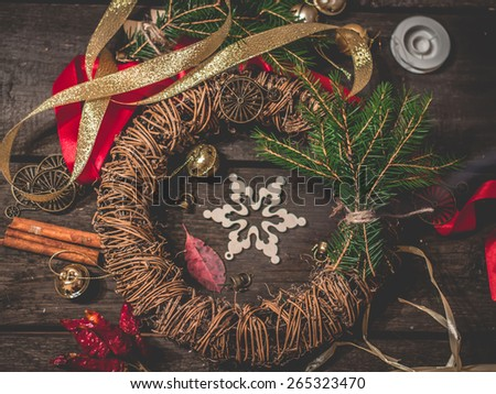 Christmas wreath on a wooden table production.  Selective focus. - stock photo