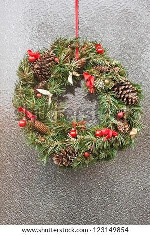 Christmas wreath on door. - stock photo