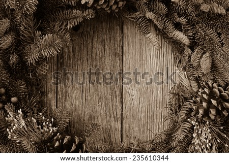 Christmas Wreath on Rustic Wood Background - stock photo