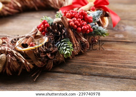 Christmas wreath on rustic wooden background - stock photo
