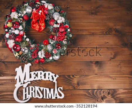Christmas wreath on the wooden background - stock photo
