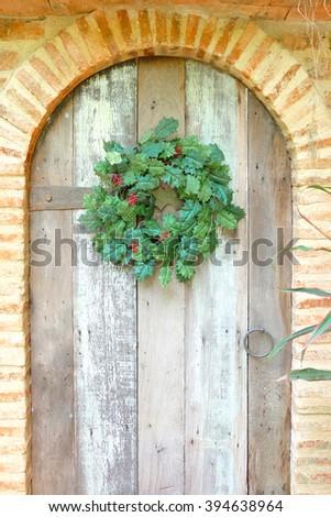 Christmas Wreath on Vintage Wooden Door - stock photo