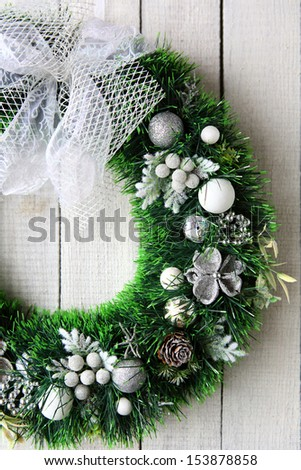 Christmas wreath on white door, holiday - stock photo