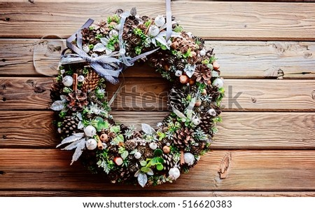 Christmas wreath on wooden rustic background. Space for text. Merry Christmas