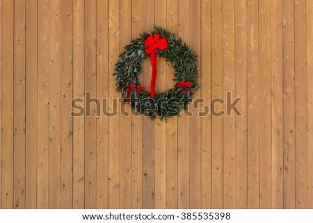 Christmas wreath on wooden wall horizontal for a yuletide background image
