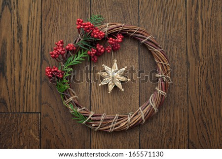 Christmas wreath over wooden background - stock photo