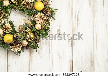 Christmas wreath with baubles useful as christmas background. - stock photo