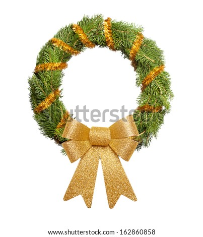 Christmas wreath with big golden bow on white background - stock photo