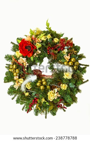 Christmas wreath with flowers and Christmas jewelery, ribbons and lights, with two white birds - stock photo