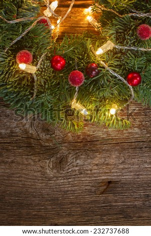 christmas wreath with lights on wooden table