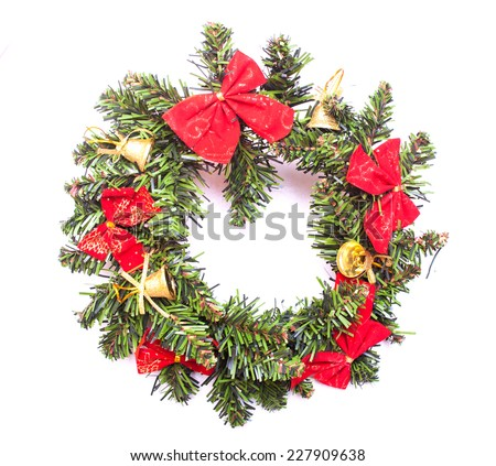 Christmas wreath with red tie and yellow bell isolated on white - stock photo