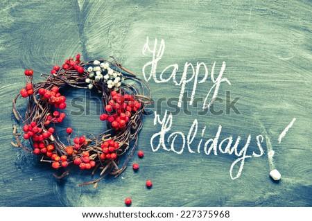 Christmas wreath with retro filter - stock photo