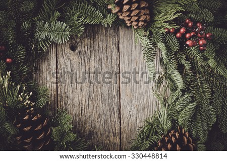 Christmas Wreath with Rustic Wood Background - stock photo