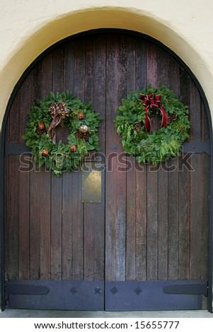 Christmas wreaths on oak front door Napa Valley California - stock photo