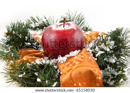 Christmas wreaths with fresh red apple on the white background - stock photo